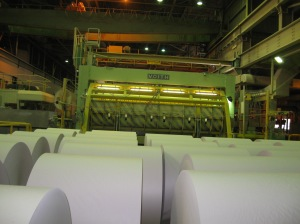 Rolls of fresh newsprint emerge from the cutting machine, Norske Skog mill, Kawerau, Dec 2012